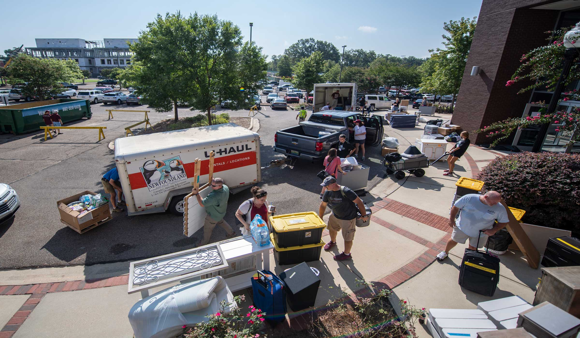 New MSU students move in with the assistance of volunteers, family and friends.