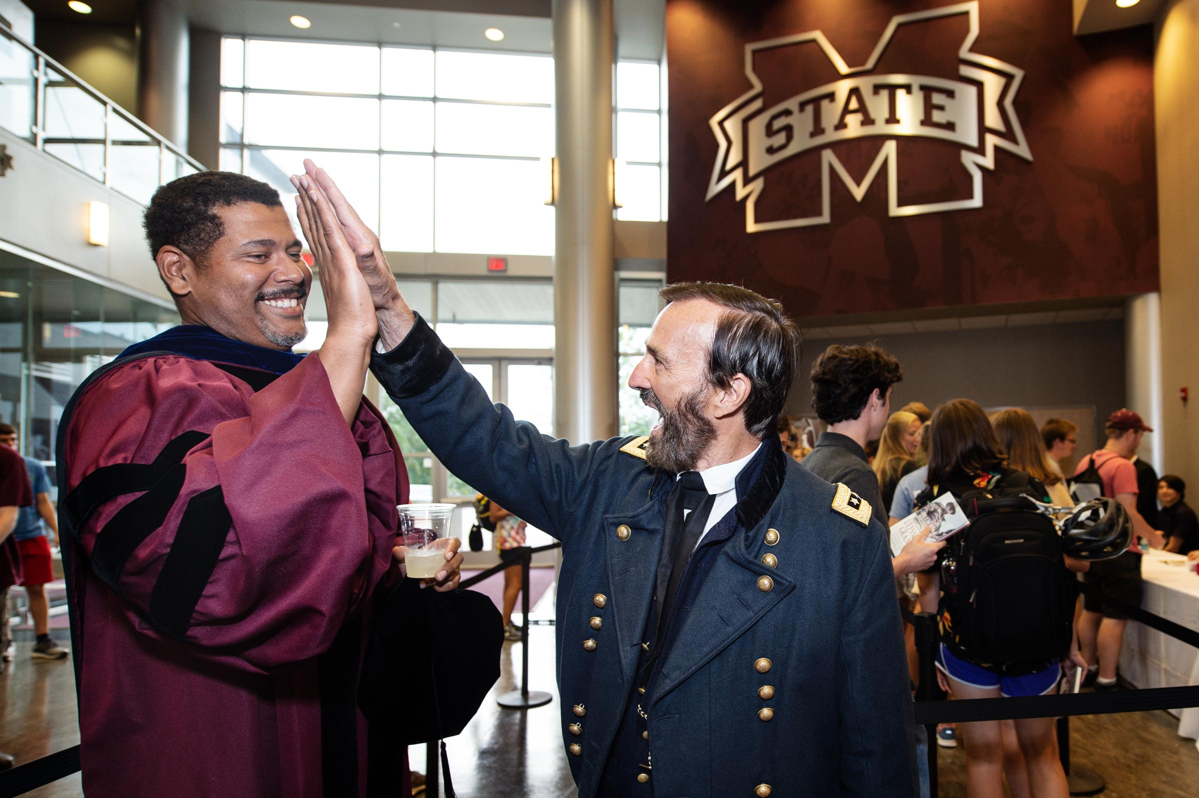 Ulysses S. Grant high-fives Professor Donald Shaffer following the Convocation ceremony in Humphrey Coliseum.