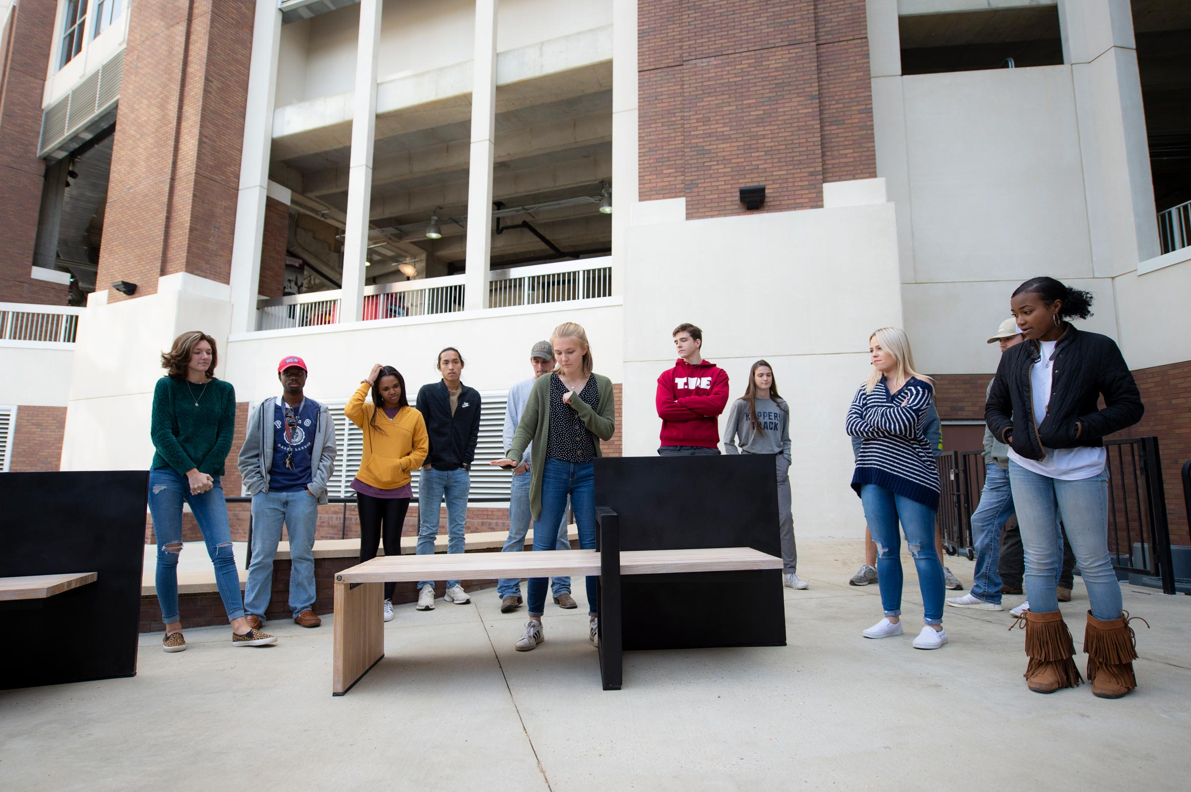 Ruthie Southall, a member of group one, explains the features of their handicap accessible bench during Architecture-Building Construction Science bench project presentations.