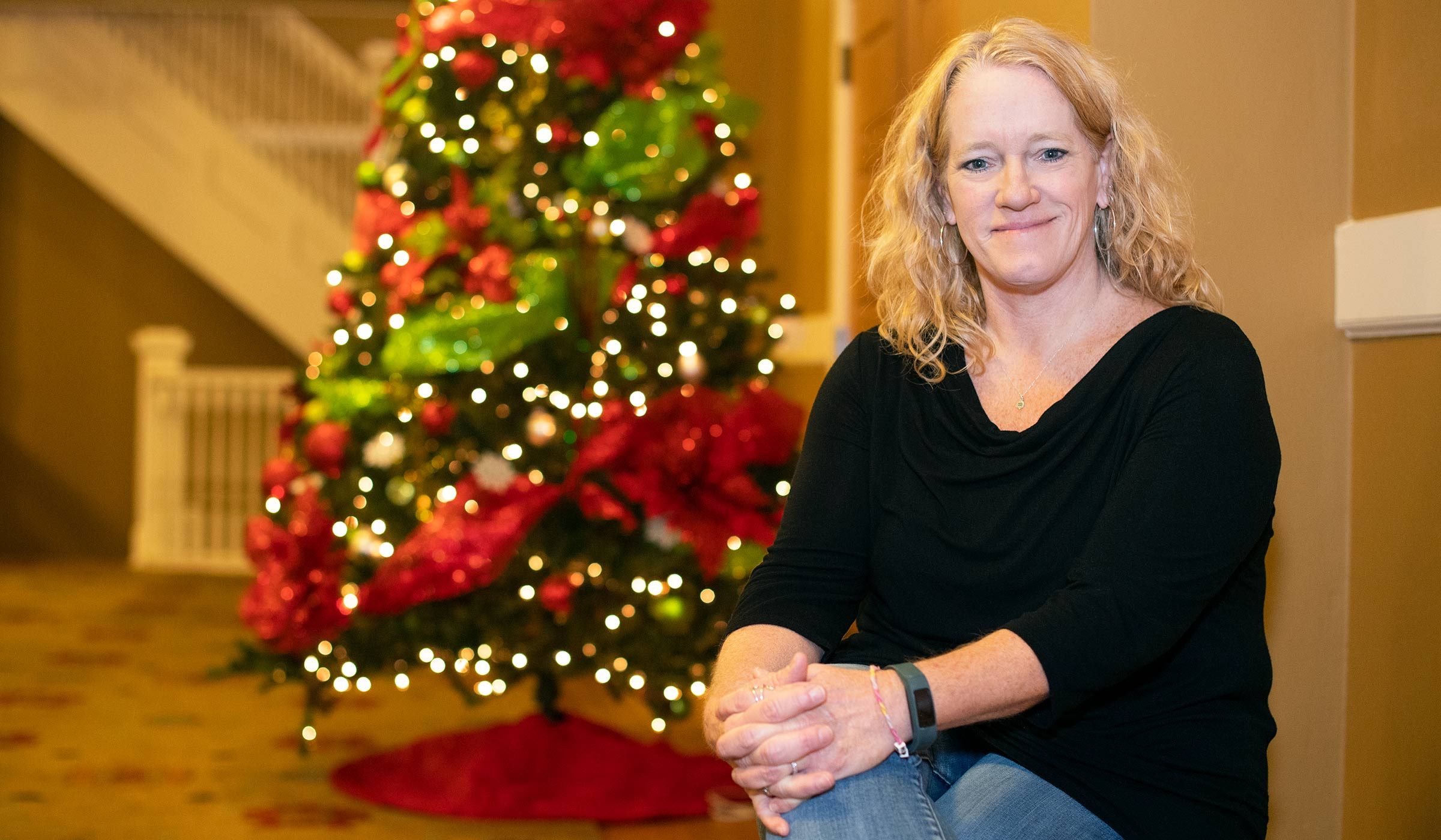 Lisa McReynolds, pictured in front a Christmas tree in Lee Hall.