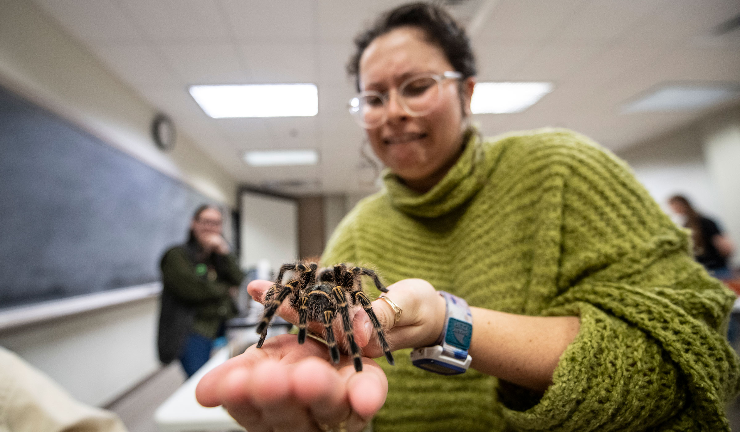 Nadia Nelson conquers her fear and holds one of Science Night's most famous attendees a tarantula named The Ambassador.