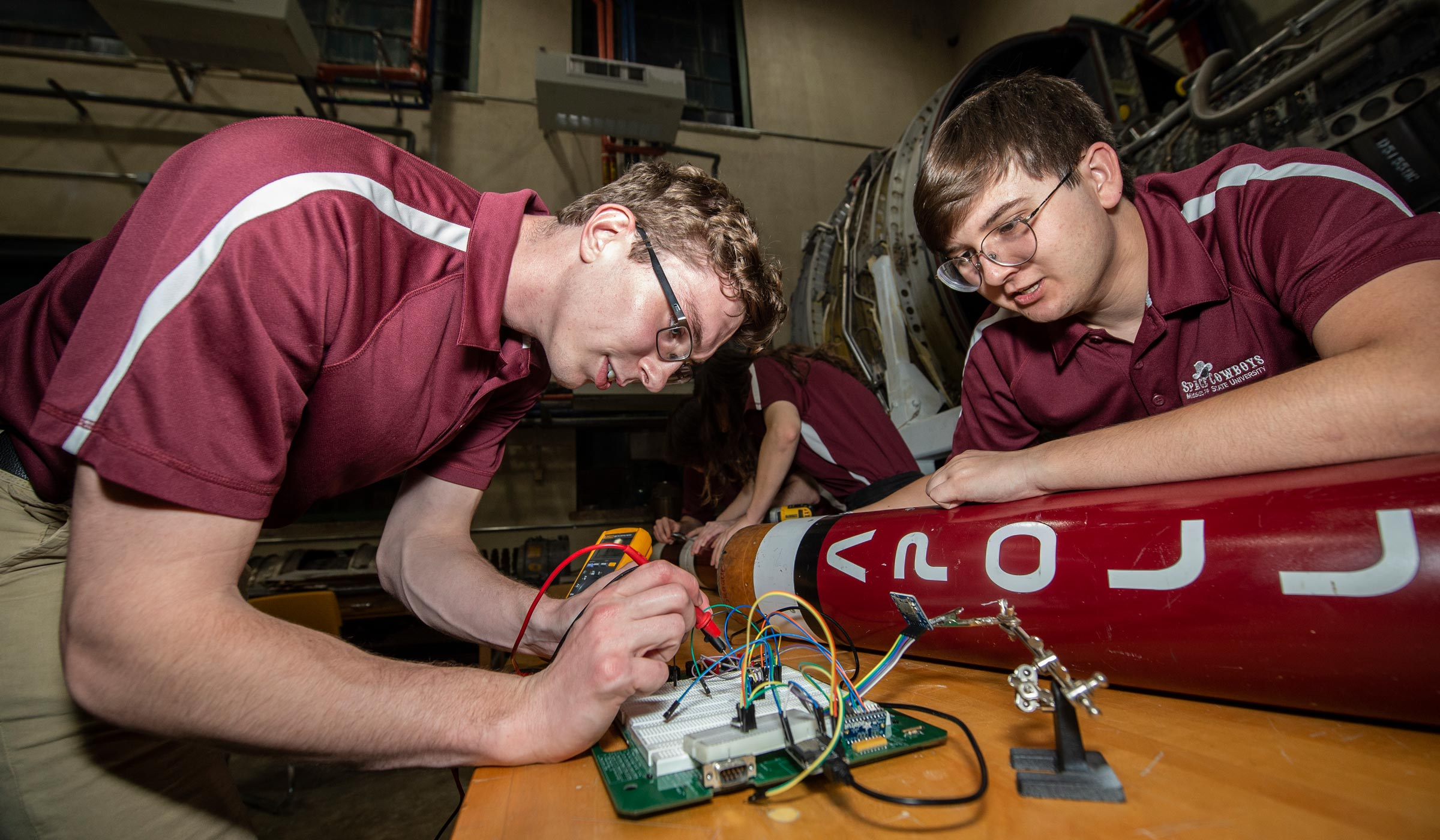 Spencer Lampkin (sl1611) and Chase Wornex (cww209) work on a rocket during a Space cowboys meeting.