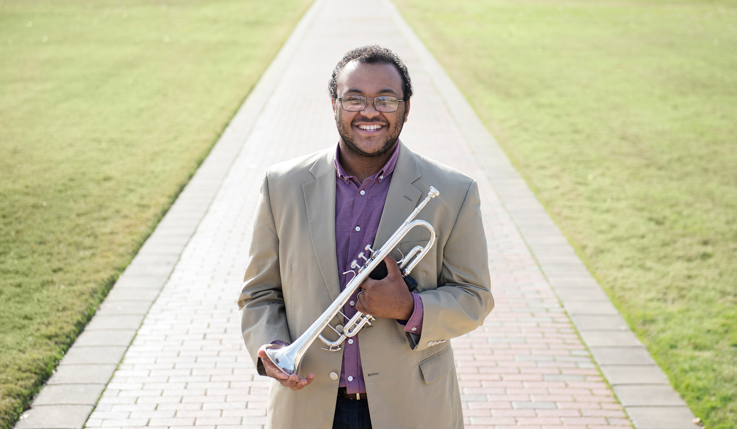 Quin Gray, pictured holding a trumpet on the Drill Field.