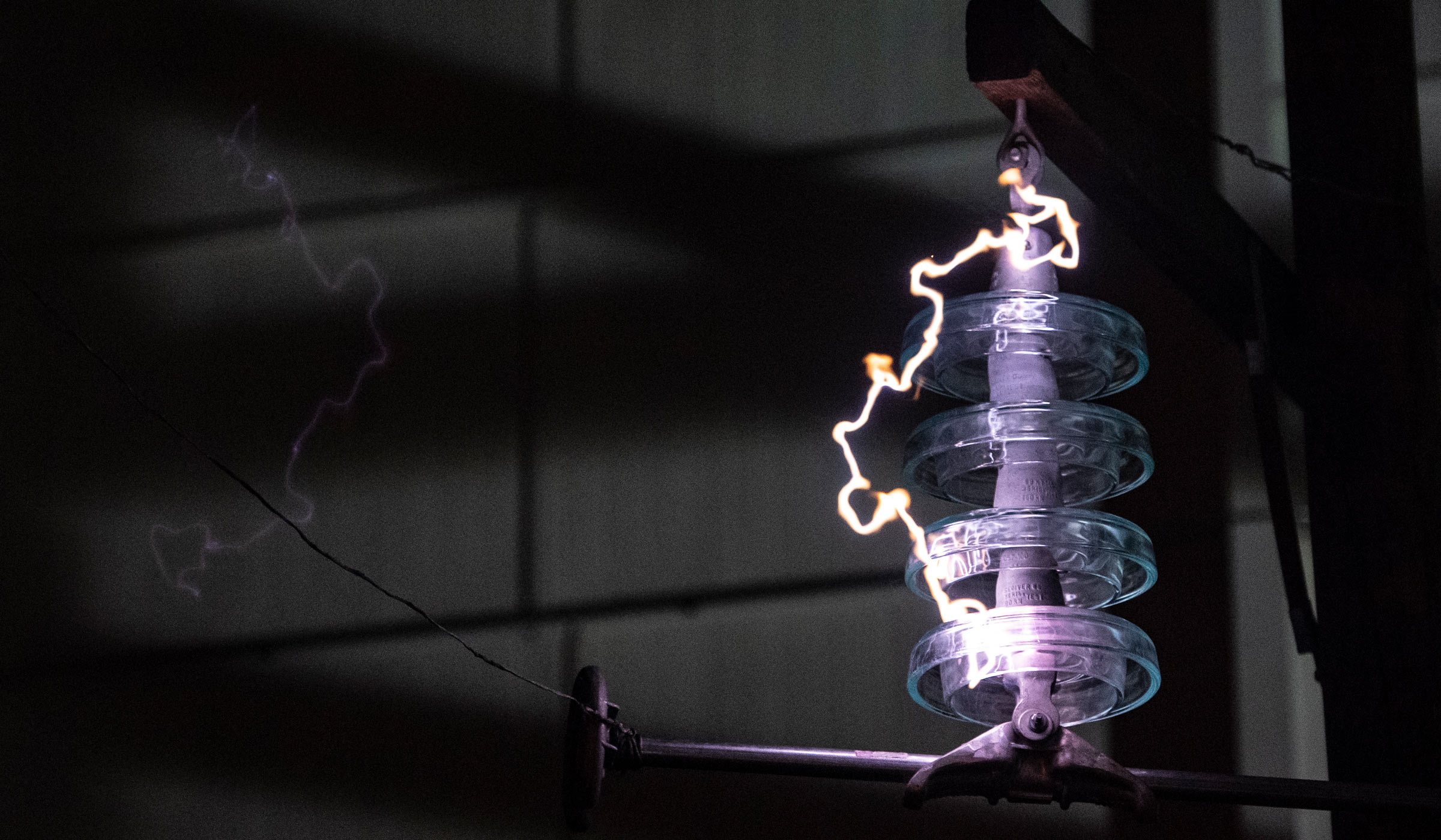 A bolt of electricity is visible in the High Voltage Lab.