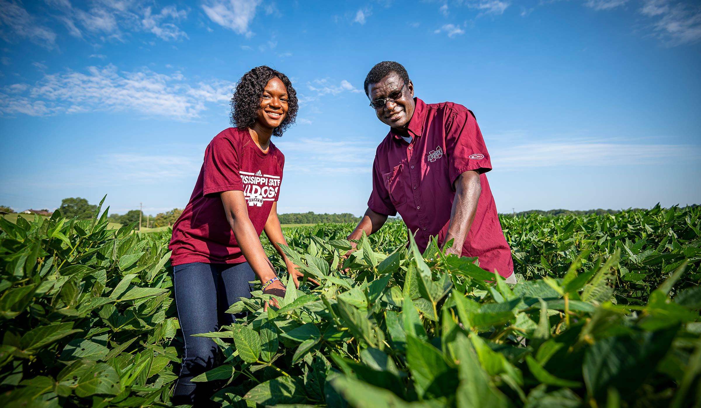 George Awuni and Urita Agana, pictured among a row of crops.