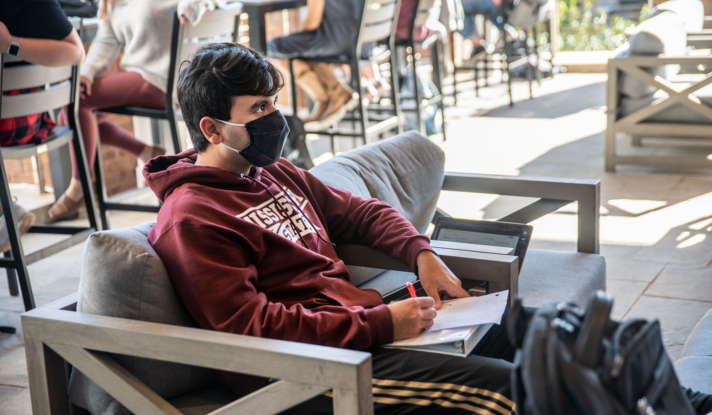 Software Engineering major Aaron Williams studies at one of the couches at Colvard Union's the recently covered porch space.