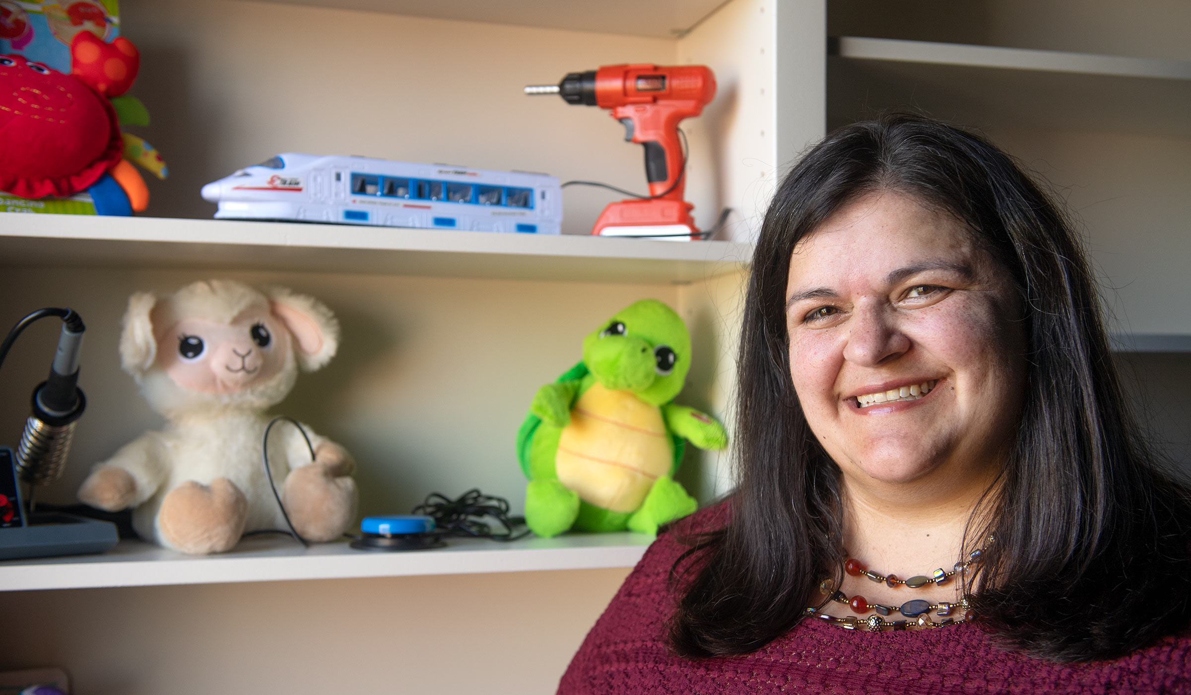 Jean Mohammadi-Aragh, pictured in front of a shelf of toys in her office.