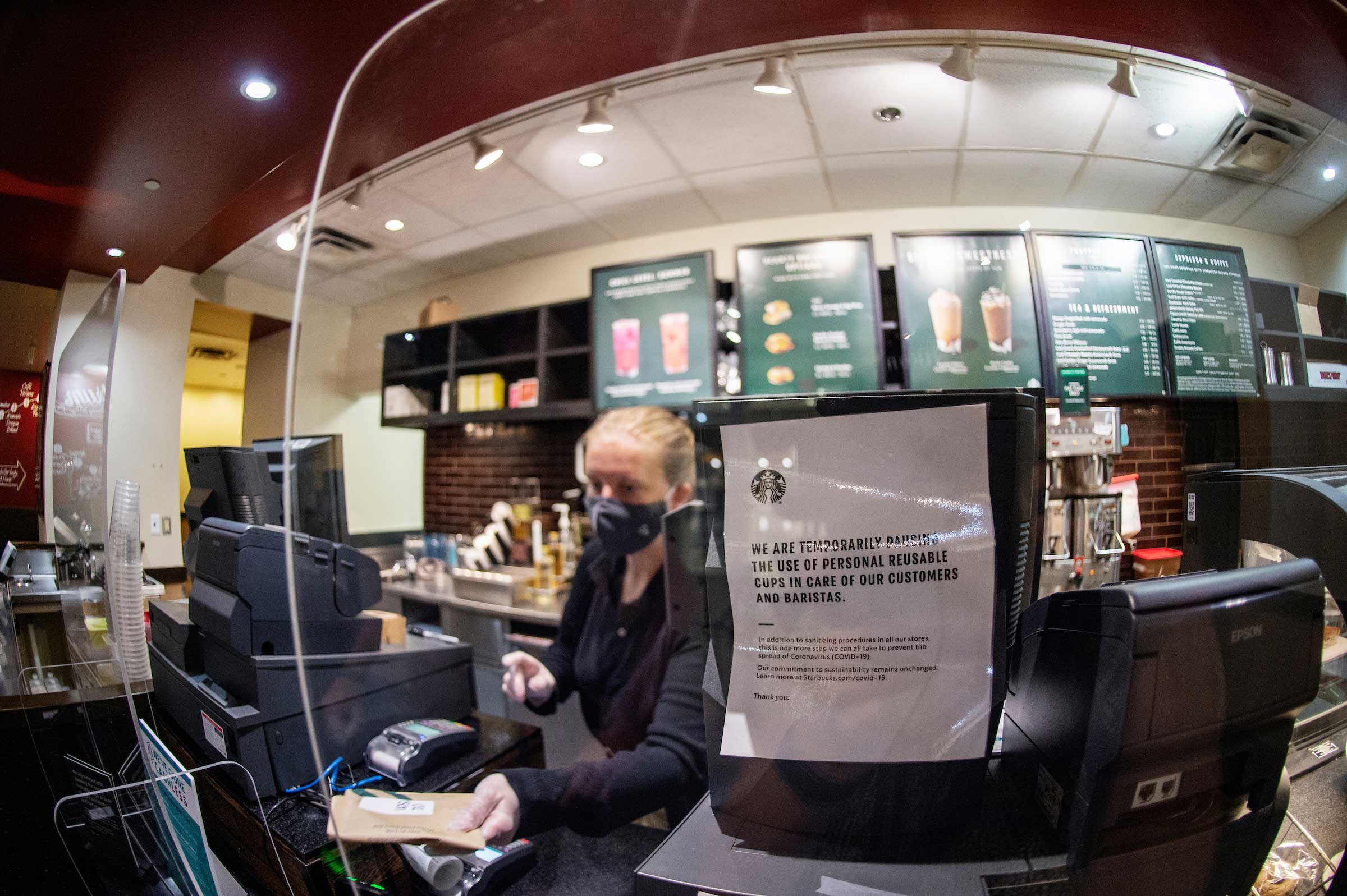 COVID signage at Starbucks order window