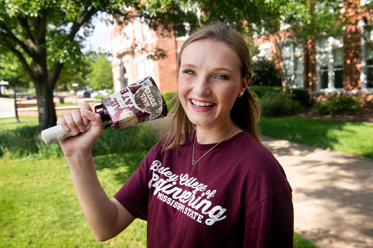Caroline Bearden, pictured ringing a cowbell on the MSU campus.
