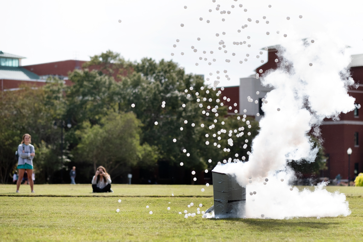 As part of ChemDawgs fun chemistry demos, Ping Pong balls and liquid nitrogen smoke explode from a trashan on the Drill Field.