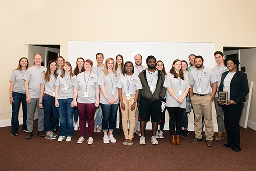 Participants in Mississippi State's 11th annual Biological Sciences Undergraduate Research Program symposium pose with faculty members and keynote speaker Veronica Scott, far right, after Friday's [April 6] award ceremony. (Photo by Beth Wynn)