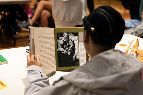 A student reads a book in the John Grisham Room during a National African American Author Read-In event at MSU's Mitchell Memorial Library.