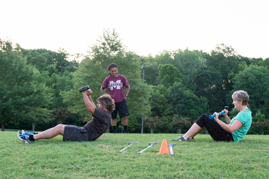 "Participants workout during a morning ""Boot Camp"" session at MSU's Sanderson Center. (Photo by Beth Wynn)"