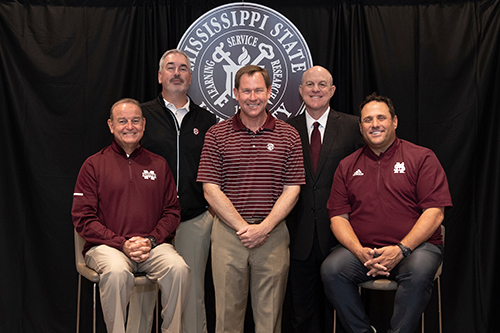 MSU coaches pose for a picture before the Summit for Scouting