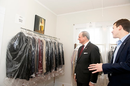 MSU President Mark E. Keenum and MSU Student Association President Jake Manning browse men's suits at Bully's Closet and Pantry.