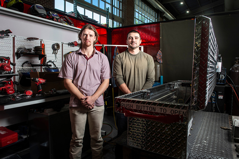 Ryden Smith and Cameron Wesley, pictured in MSU's Center for Advanced Vehicular Systems.