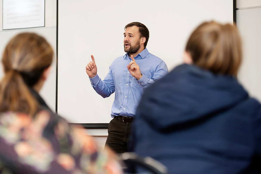 Brian Shoup, MSU associate professor of political science and public administration, speaks to students in a classroom setting.
