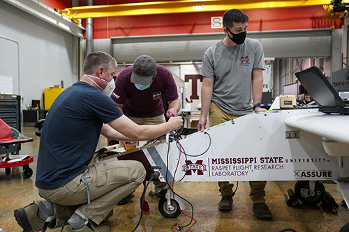 Engineers work to fine-tune an unmanned aircraft at Raspet.