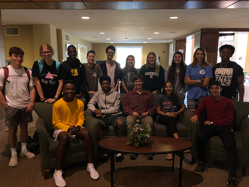 Starkville High School students smile for a group photo in the Griffis Hall lobby.