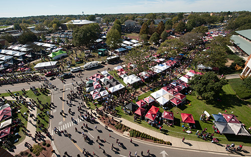 An aerial view of MSU's campus with crowded streets on gameday.