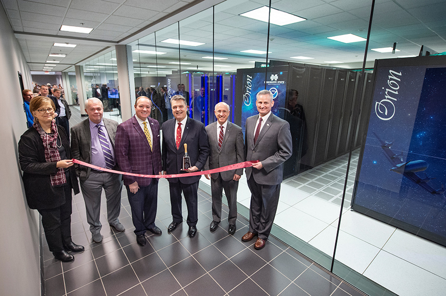 MSU and NOAA personnel cut a ribbon for the Orion supercomputer