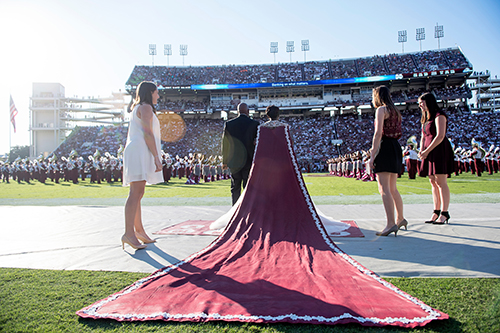 Homecoming Queen Shawanda Brooks stands in front of packed crowd at Davis Wade Stadium.