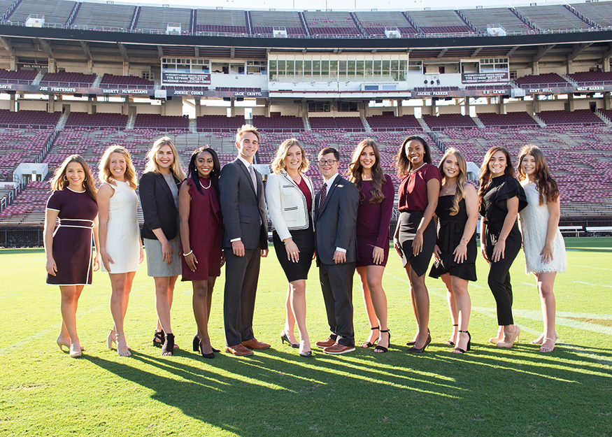 MSU's 2019 Homecoming Court members smile for a group photo while standing on Scott Field inside Davis Wade Stadium.