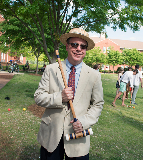 Chris Snyder, dean of MSU's Shackouls Honors College, is pictured with Oxford study abroad program participants at a spring croquet social in the Griffis Hall courtyard. Snyder is among world-class honors faculty who enjoy sharing knowledge and providing mentorship to students throughout their MSU experience. (Photo by Megan Bean)