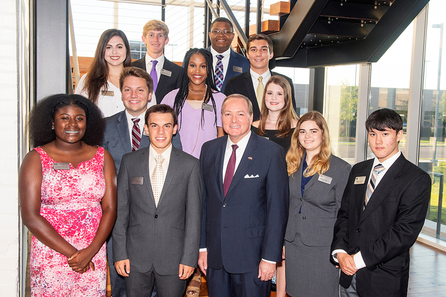 MSU President Mark E. Keenum (front row, center) visited with the university's newest Presidential Scholars during a recent dinner at The Mill at MSU in Starkville. Pictured are (front row, l-r) Aryonna Johnson of Macon, Reese Dunne of Starkville, (Keenum), Maeve Rigney of Madison, Marcus Jordan of Texarkana, Texas; (middle row, l-r) Tyler Dickerson of Starkville, Kayla Powe of Meridian, Anne Elizabeth Harrington of Madison; (back row, l-r) Flora Dedeaux of Gulfport, Graham Roberson of Jackson, Christopher Robinson of Brookhaven and Ryan Jarratt of Vicksburg. (Photo by Beth Wynn)