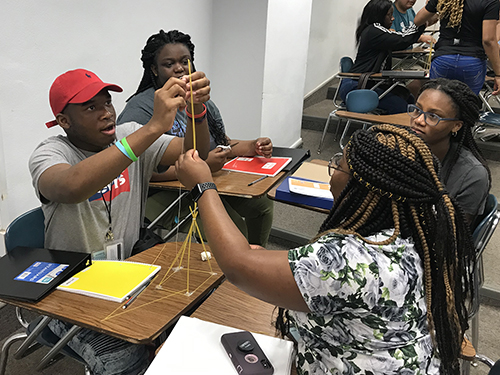 Students in the AP physics summer preparatory academy conducted by Mississippi State and the Global Teaching Project build a spaghetti tower during a lesson. Students in the two-week program achieved dramatic gains in their understanding of physics. (Global Teaching Project)