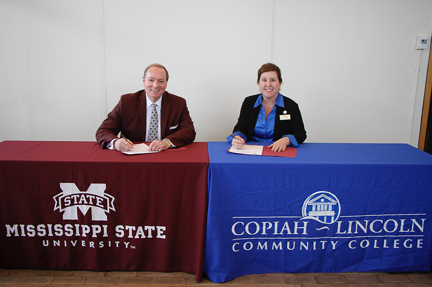 Mark Keenum and Jane Hulon sign an MOU for the Bachelor of Applied Science program.