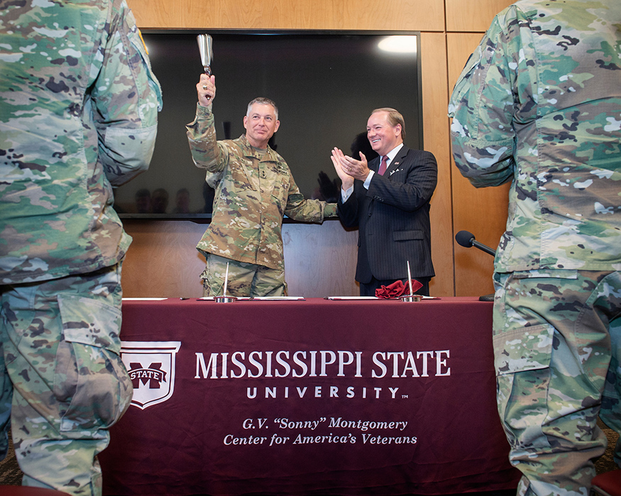 "Maj. Gen. Janson D. ""Durr"" Boyles, Adjutant General of Mississippi, and Mississippi State University President Mark E. Keenum celebrate after signing a memorandum of agreement between MSU and the Mississippi National Guard to establish the Bulldog Free Tuition Program. The new program ensures free tuition for eligible Mississippi National Guard service members enrolled full-time at MSU. (Photo by Megan Bean)"