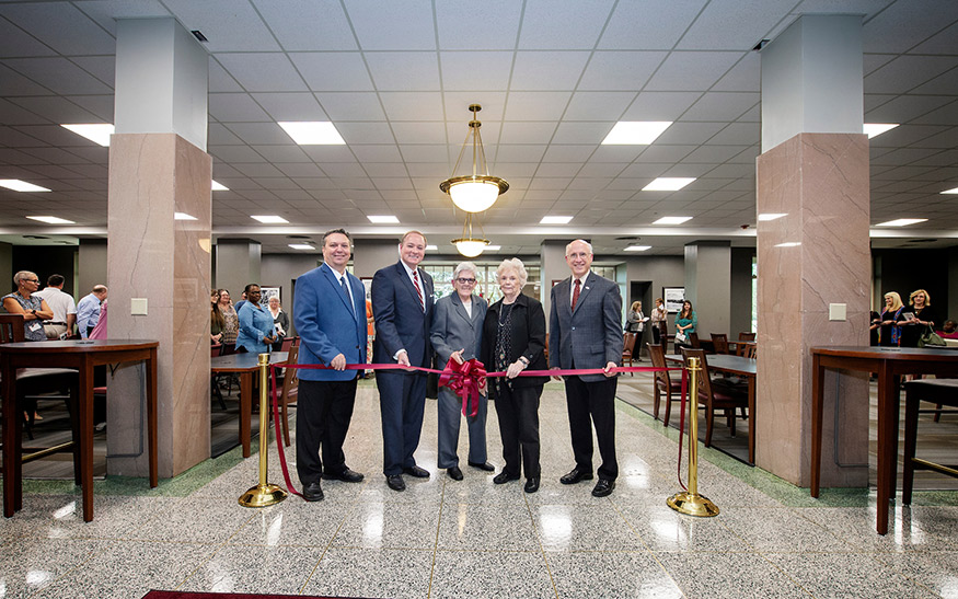 MSU alumna Janice I. Nicholson cutting a ribbon surrounded by Associate Dean of MSU Libraries Stephen Cunetto; MSU President Mark E. Keenum; Dean of Libraries Frances Coleman; and Provost and Executive Vice President David Shaw