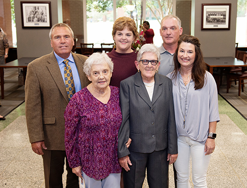 MSU alumna Janice I. Nicholson, facility benefactor, center front, with her brother's family, front left, wife Mary Jane McGee Nicholson, an MSU alumna; front right, daughter-in-law Sherri Nicholson; and back from left, son-in-law Chris Barr, daughter and MSU alumna Jane Nicholson Barr, and son and MSU alumnus James W. Nicholson III.