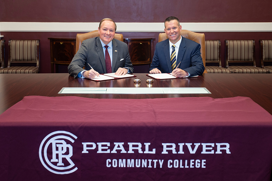Mark Keenum and Adam Breerwood sign and MOU at Mississippi State