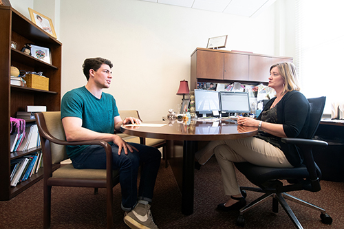 MSU student Reed Bigham meeting with MSU faculty member Mary Celeste Reese