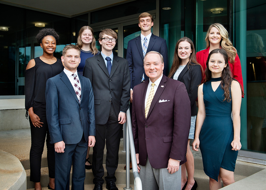 MSU's newest Presidential Scholars take a group photo with President Mark E. Keenum at The Mill at MSU in Starkville.