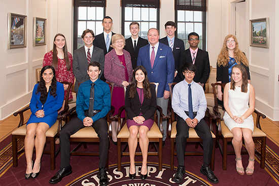 MSU Provost and Executive Vice President Judy Bonner (middle row, third from left) and President Mark E. Keenum (middle row, fourth from left) welcome the newest class of Mississippi State University Provost Scholars. From left to right, they include (front row) Shanika Musser, Christopher Clements, Georgiana Swan, Chuyen Nguyen, Mary Lee; (second row) Hannah Scheaffer, James Warren, Bonner, Keenum, Chirantan Sen Mukherjee, Abigail Crouse; (third row) Mitchell Harvey, Brady Kruse and Colton Watson. (Photo by Beth Wynn)