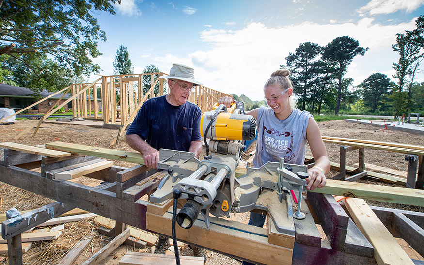An MSU student volunteers alongside a community member as part of the annual Maroon Edition project in partnership with Starkville Area Habitat for Humanity.
