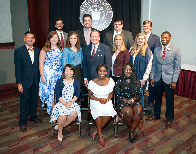 Pictured with MSU President Mark E. Keenum (middle row, center) are the 2017 Spirit of State honorees. They include (front, l-r) Jian Jiang, Shawanda Brooks, Terranecia Henderson (middle, l-r) Isaac Lias Jr., Caitlin Fournier, Shelby Williams, Roxanne Raven, Lauren Kiefer, Jeremy Knott (back, l-r) Mukhunth Raghavan, Roy Jafari, Alex Maxwell and Sam Andrews. Not pictured, Feifei Zeng also is an honoree. (Photo by Russ Houston)
