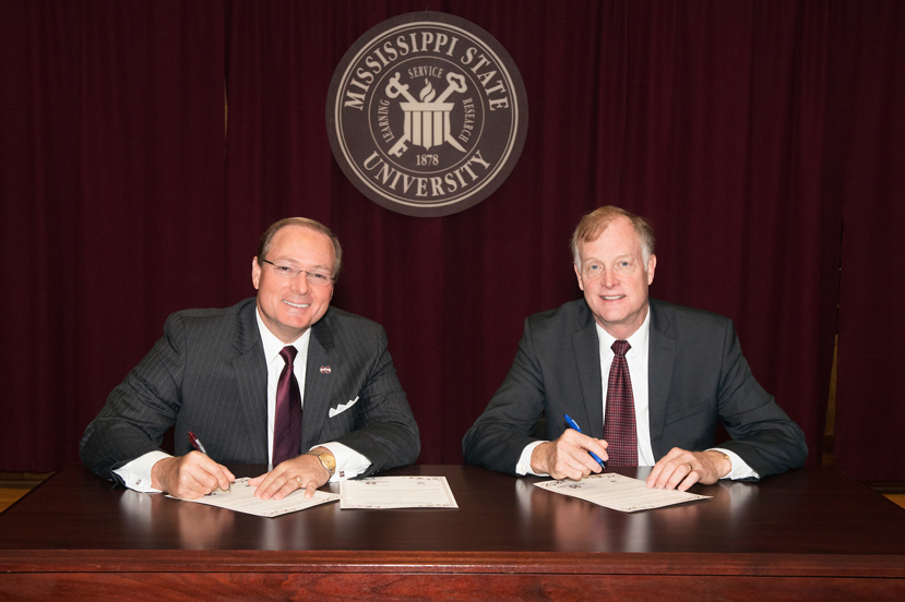 "MSU President Mark E. Keenum and USDA APHIS Wildlife Services Deputy Administrator William H. Clay signed a ""Resolution for Collaboration"" to create a national training academy housed at Mississippi State. (Photo by Beth Wynn)"
