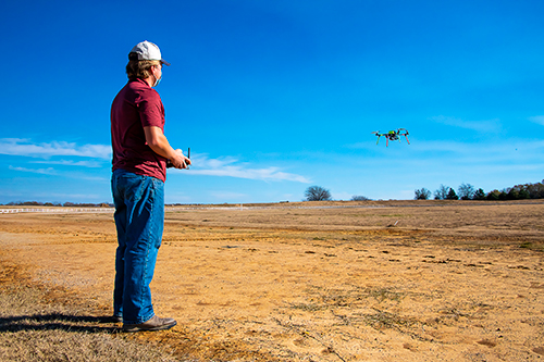 Bryan Whittenton of Forrest City, Arkansas, a plant and soil sciences doctoral student, flies a student-built 650 class rotocopter at the MSU Horse Park.