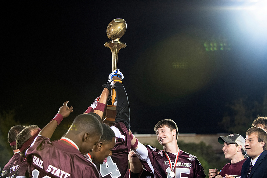 MSU students and Special Olympics Mississippi athletes celebrate winning a recent Unified Sports Egg Bowl. (Photo by Beth Wynn)