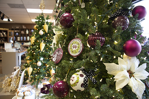 A Christmas tree decorated in maroon and white ornaments at the University Florist