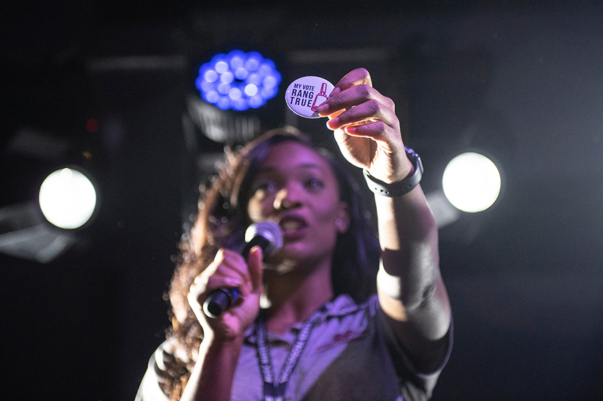 """MSU Student Association President Mayah Emerson, a senior educational psychology major from Meridian, speaks to students at last November's """"Wrap the Vote"""" concert to encourage student voting. (Photo by Logan Kirkland)"""