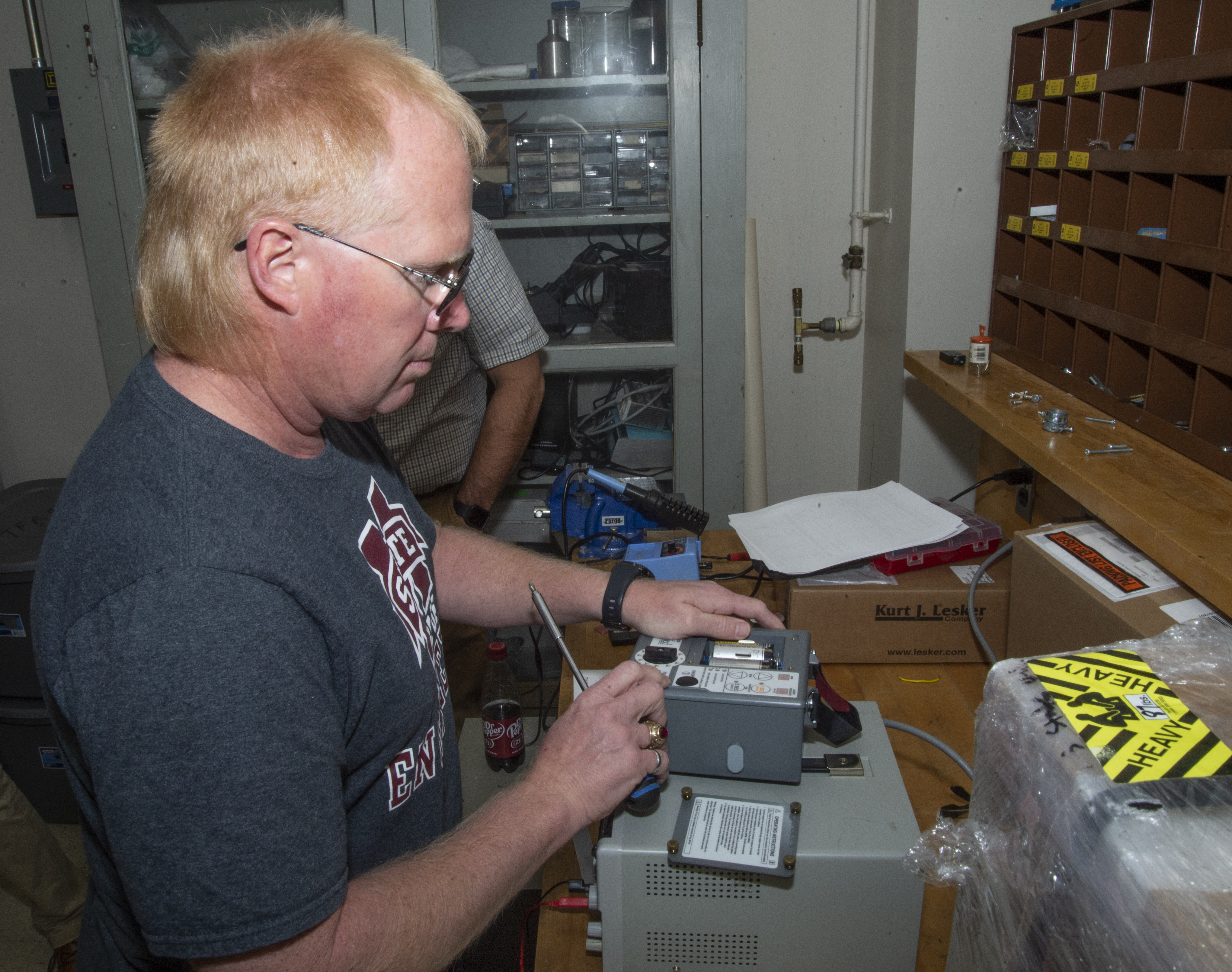 David Wallace works on a ventilator at MSU's High Voltage Lab