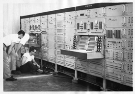 Early black and white photo of MSU students in a computer lab.